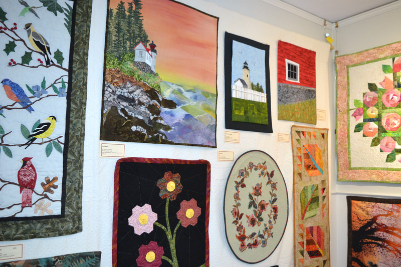 Numerous art quilts line the center room of the Pemaquid Watershed Association office-gallery in the current Clamshell Quilters show, running through Wednesday, Nov. 21. (Christine LaPado-Breglia photo)