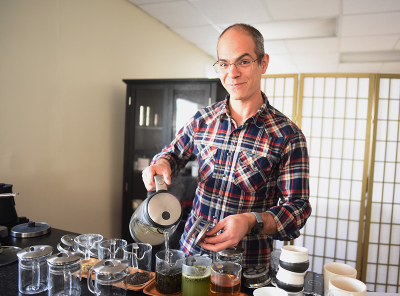 Samovar Tea President Jacobs pours water over tea leaves Friday, Nov. 9. (Jessica Picard photo)