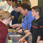 NCS Eighth-Graders, Superintendent Serve Thanksgiving Dinner