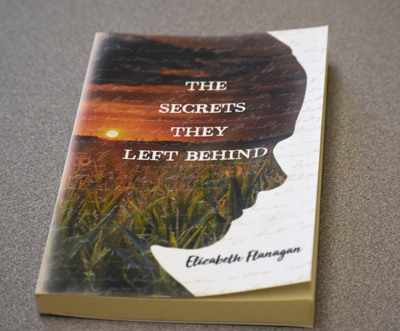 "The cover of Elizabeth Flanagan's first novel, ""The Secrets they Left Behind."" (Alexander Violo photo)"