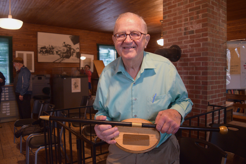 Albert Boynton holds a replica of Whitefield's Boston Post Cane. Boynton, 92, holds the cane as the town's oldest resident. (Jessica Clifford photo)