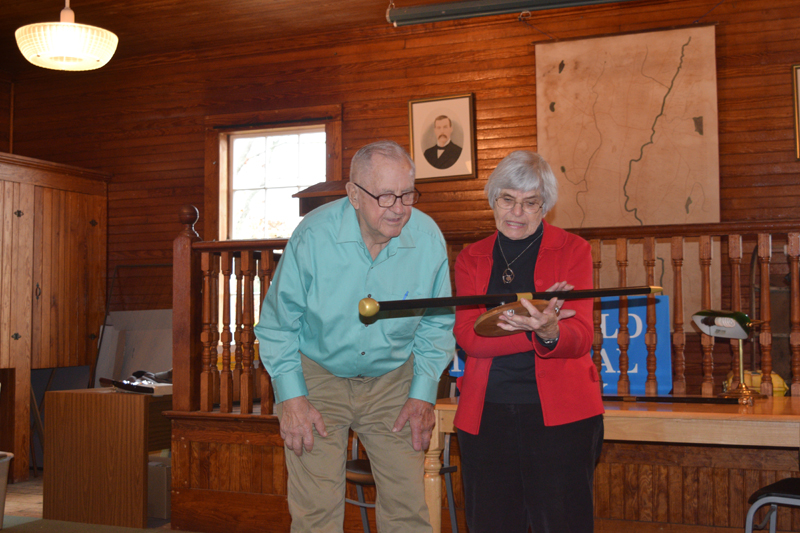 Albert Boynton and Marie Sacks, an archivist for the Whitefield Historical Society, look at a plaque recognizing Boynton as the town's oldest resident. (Jessica Clifford photo)
