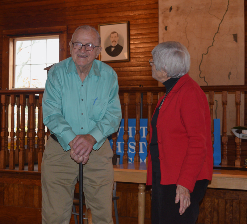 Albert Boynton leans on a replica of Whitefield's Boston Post Cane as Marie Sacks looks on during a ceremony at the Whitefield Historical Society on Saturday, Nov. 3. (Jessica Clifford photo)