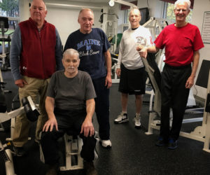 A small group of men, four of the five cancer patients or survivors, gathers at the Wiscasset Community Center several times a week to work out and support one another. From left: Bob Summers, Dan Plummer (seated), Phil Withee, Chuck Shea, and Glenn Milley. (Photo courtesy Katrina Willey)
