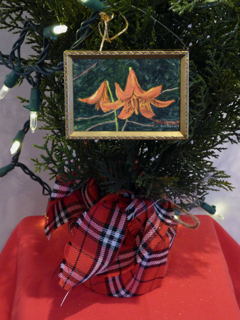 "Janice Anthony's double-sided ornament ""Canada Lilies."""