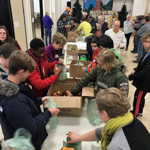 The Ecumenical Food Pantry in Newcastle coordinates the preparation of Thanksgiving food baskets.