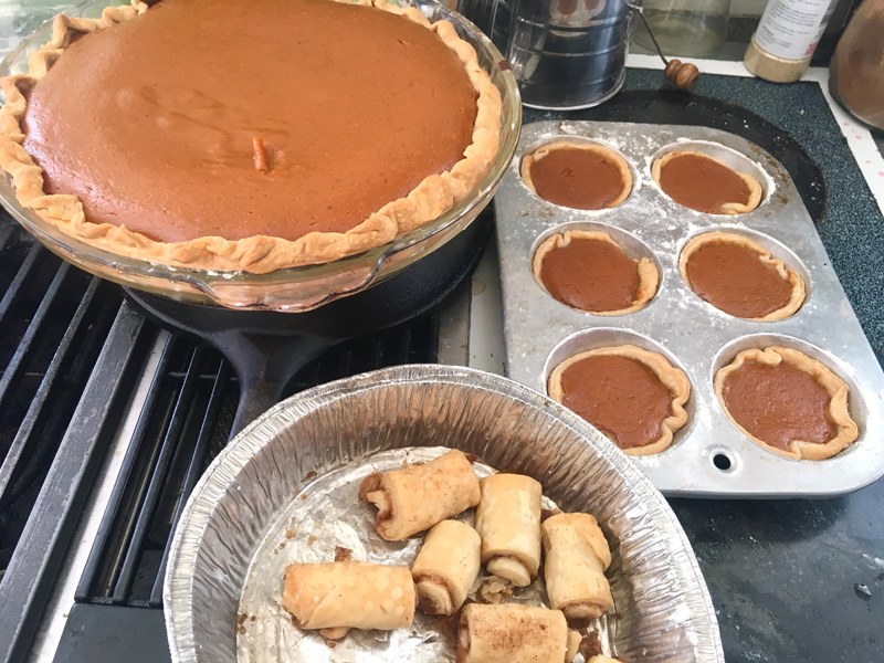 A pumpkin pie and some of its offspring: pumpkin cuppies and cinnamon rolls. (Suzi Thayer photo)