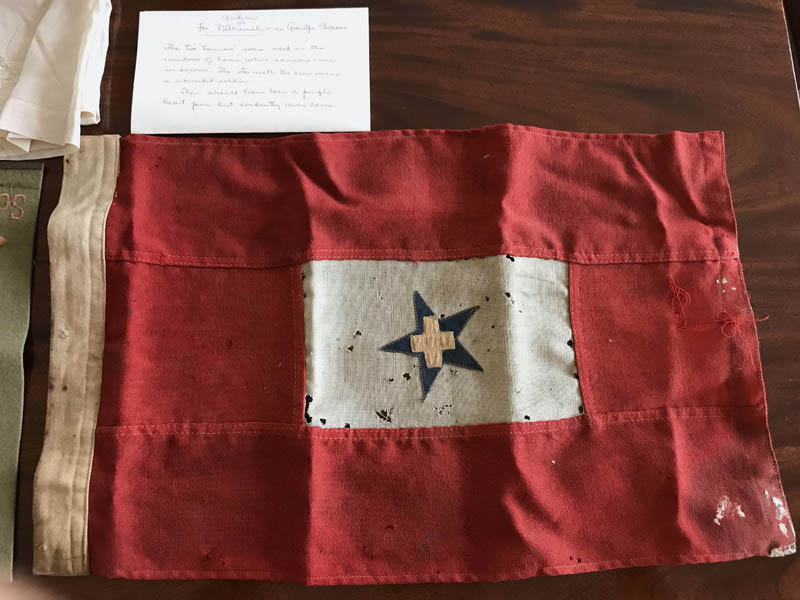 During World War I, families would hang banners like this one in a window of their home when a family member was in the service. The star with the cross means the service member was wounded. (Photo courtesy Mary Ann Chase Vinton)