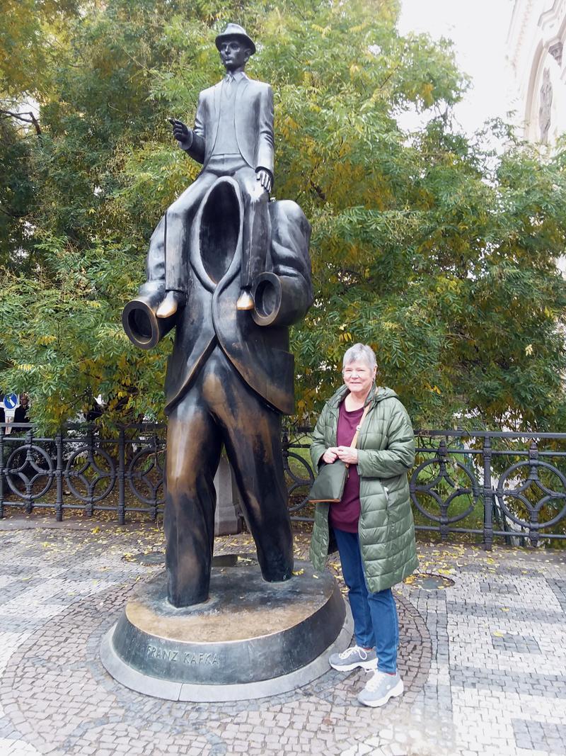 Pamela Gormley visits the Franz Kafka monument in Prague.