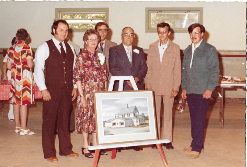 From left: (front row) Jerry Farrin, Gail Poole, Carl Poole Sr., and Carl Poole Jr.; and (back row) Craig Leeman and Gordon Bailey at the announcement of the new showroom addition (shown on easel) at Pemaquid Falls.