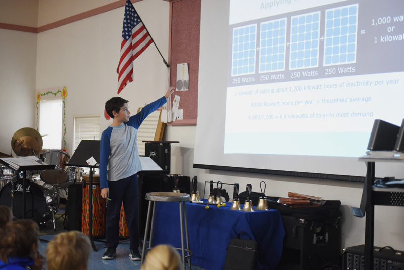 Bristol Consolidated School sixth-grader Joshua Arzate points to a slide during a presentation on solar energy to younger students Thursday, Nov. 29. (Jessica Picard photo)