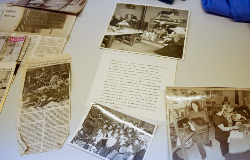 Old newspaper clippings and photos tell the story of People to People, which is celebrating its 50th anniversary this year. At bottom right is an undated photo of Shirley Tibbetts, who now runs the service. (Jessica Picard photo)