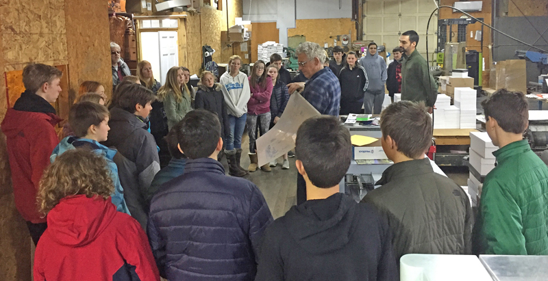 Chris Roberts, publisher of The Lincoln County News, explains the printing process to Great Salt Bay Community School eighth-graders during their tour of the Lincoln County Publishing Co. plant in Newcastle.