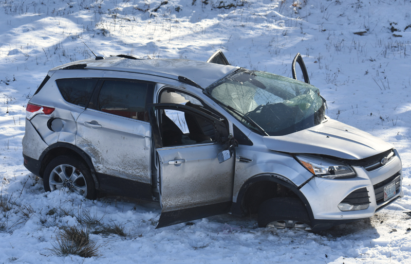 A 2014 Ford Escape SUV shows heavy damage after rolling over and down an embankment on East Pond Road in Nobleboro the morning of Tuesday, Dec. 18. (Alexander Violo photo)