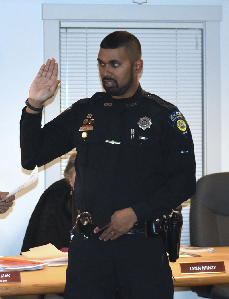 Officer Nathaniel Jack, of the Waldoboro Police Department, takes the oath of office during a ceremony at the municipal building Dec. 11. (Alexander Violo photo)