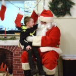 Santa Visits Children at Whitefield Party