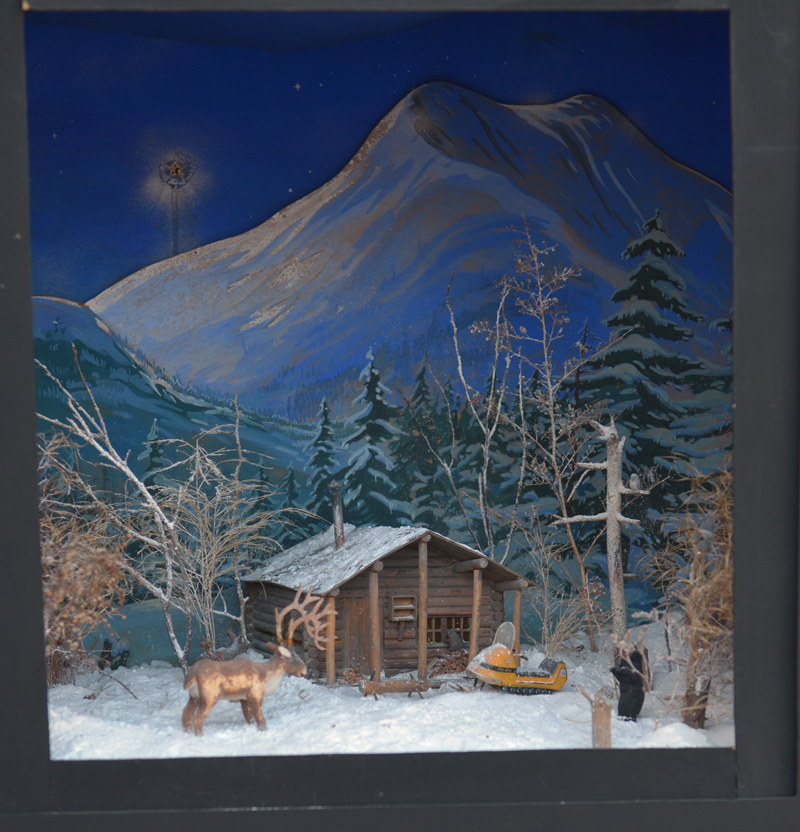 A cabin in the woods scene is one of Jake Day's dioramas on display at Milling Around in Newcastle through Jan. 5.
