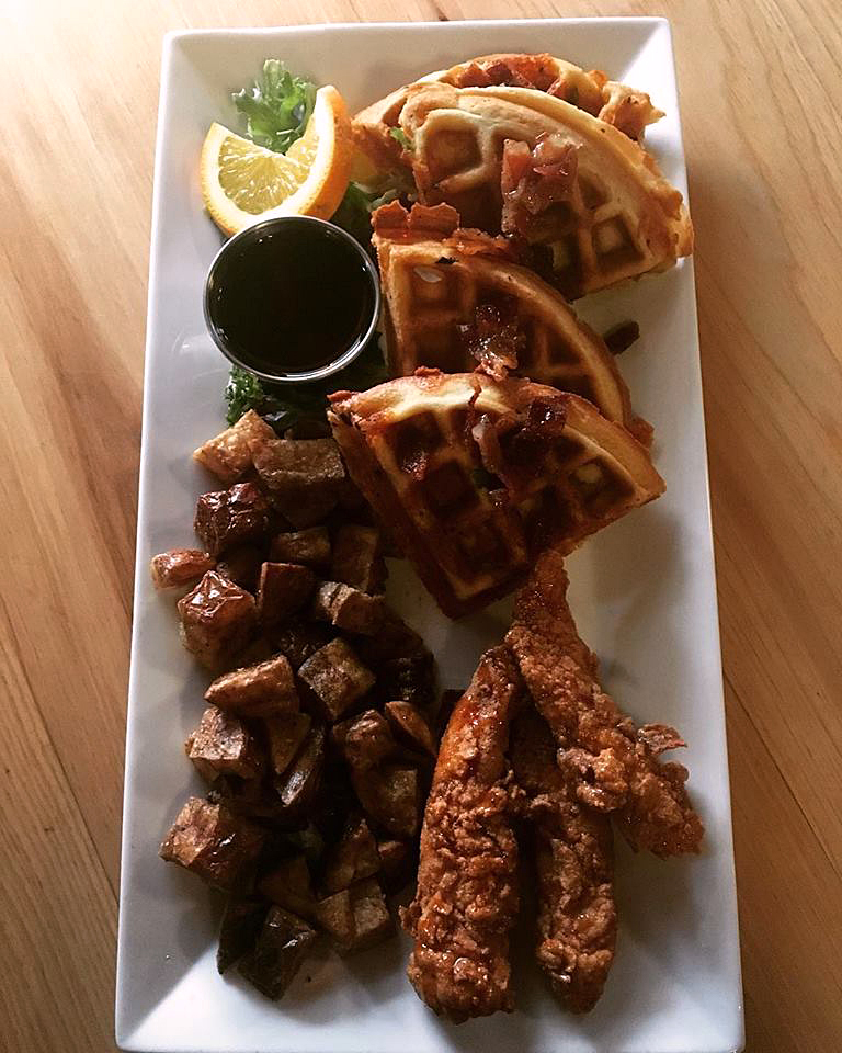 Fried chicken and waffles is a popular brunch dish at The Harbor Room in New Harbor.