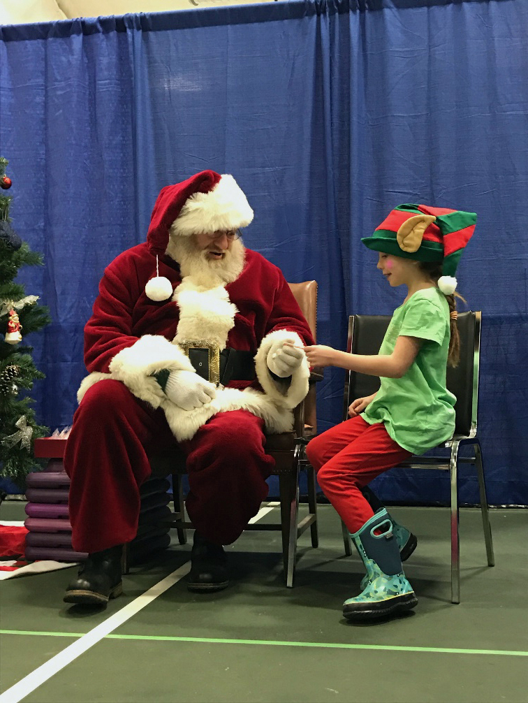 Reese Nelson enjoys a chat with Santa Claus.