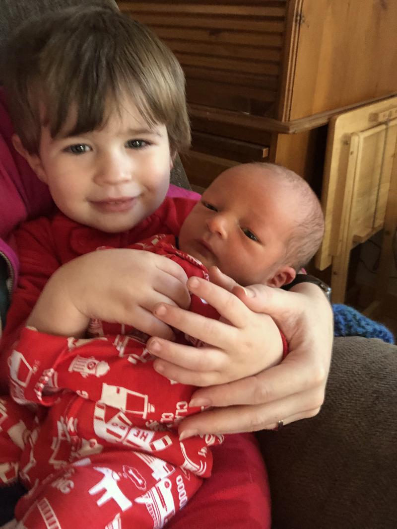 Thomas Sutter holds his little brother, Emmett Brice Sutter.