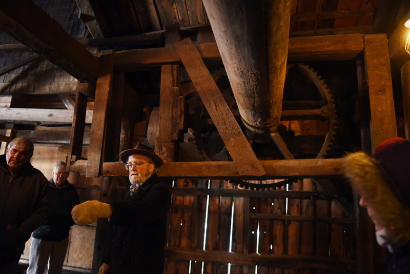 Phil Averill shows a tour group equipment from the 1800s-era Pemaquid Mill during a tour of the building Thursday, Jan. 17. (Jessica Picard photo)