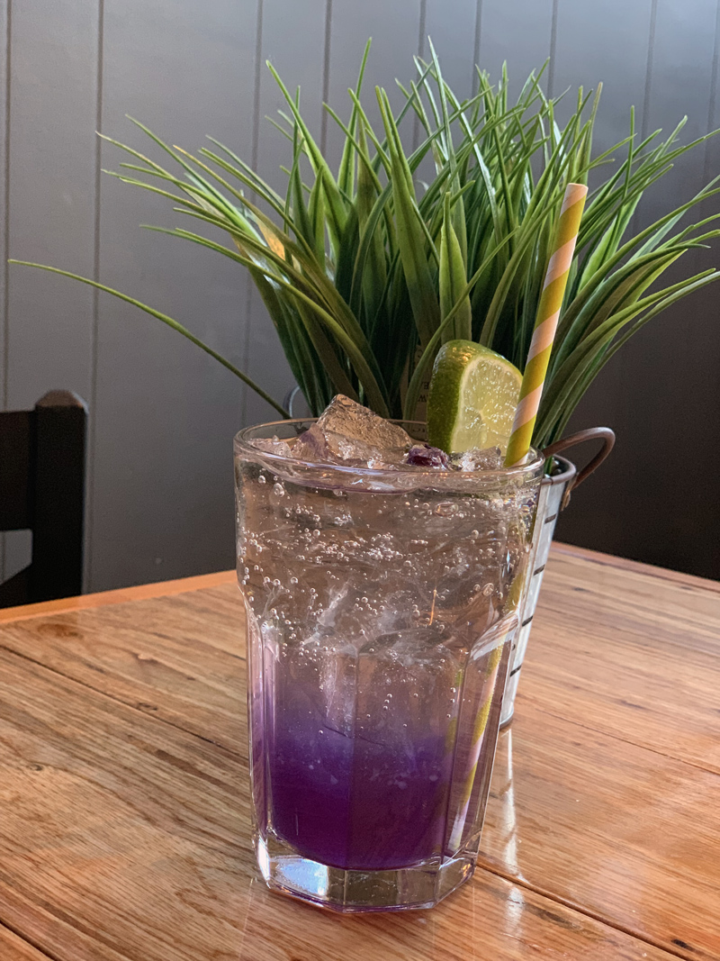 Butterfly pea flower tea, on ice, by Em Limvathanalert. (Suzi Thayer photo)