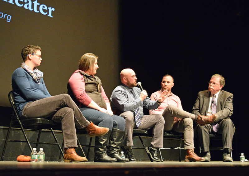 Damariscotta Police Chief Jason Warlick (center) speaks during a community discussion about the opioid crisis at the Lincoln Theater in Damariscotta on Tuesday, Jan. 29. From left: panelists Dr. Catherine Cavanaugh, Amanda Welch, Warlick, Dr. Tim Fox, and Don Carrigan. (Jessica Clifford photo)