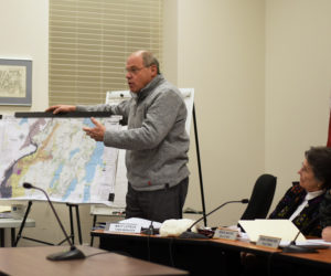 Damariscotta Town Manager Matt Lutkus uses a map to point out the town's zoning districts during a community conversation about marijuana ordinances Wednesday, Jan. 2. (Jessica Picard photo)