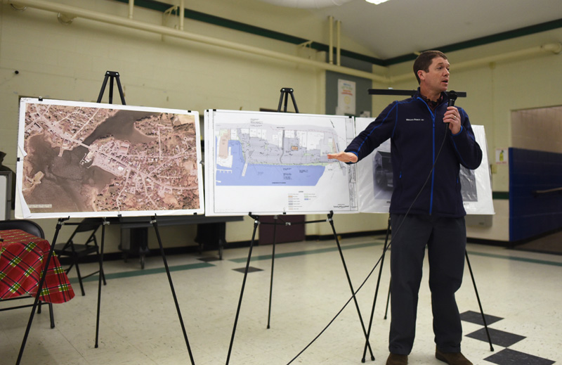 Travis Pryor, of the engineering firm Wright-Pierce, presents plans for changes to Damariscotta's municipal parking lot during a community conversation at Great Salt Bay Community School on Thursday, Jan. 17. (Jessica Picard photo)