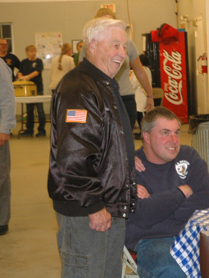 Don Hastings (left) and Paul Huber welcome visitors to Jefferson Fire and Rescue's 75th anniversary celebration in 2016. Hastings, a key figure in the training of local firefighters for more than 25 years, died Friday, Jan. 4. (Alexander Violo photo, LCN file)