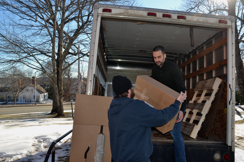 Lincoln County Publishing Co. employees Graham Burnham (left) and J.W. Oliver load a truck with newspaper archives outside the Lincoln County Courthouse in Wiscasset on Friday, Jan. 25. (Maia Zewert photo)