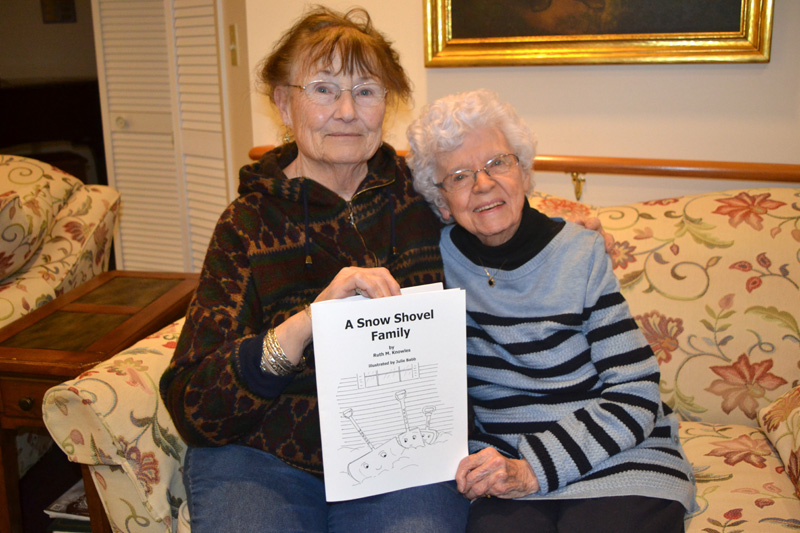 "Damariscotta artist Julie Babb (left) and Newcastle writer Ruth Knowles with Knowles' new children's book, ""A Snow Shovel Family,"" illustrated by Babb. (Christine LaPado-Breglia photo)"