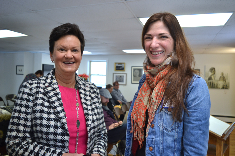 Julie Richard (left), executive director of the Maine Arts Commission, chats with Emily Peckham, director of development at Points North Institute in Rockland, at the 2019 Maine Arts Iditarod on Wednesday, Jan. 16 at River Arts in Damariscotta. (Christine LaPado-Breglia photo)