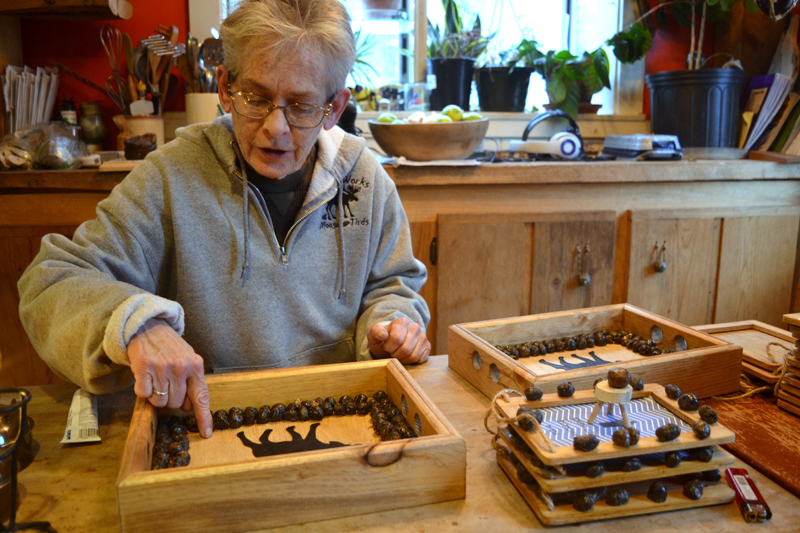 Mary Winchenbach finishes making a Poo Poo Platter, one of numerous in-demand items available from her business, Tirdy Works. (Christine LaPado-Breglia photo)