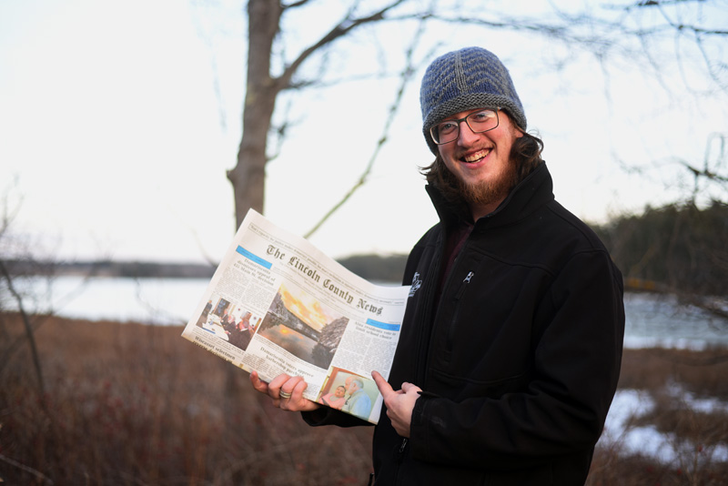 Dennis Boyd holds a copy of the March 29 edition of The Lincoln County News with his photo on the front page. The photo won the March contest before going on to take the annual contest too. (Jessica Picard photo)