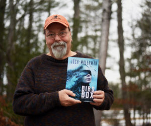 "Newcastle artist Glenn Chadbourne holds a special edition of the book ""Bird Box"" by Josh Malerman, which he illustrated. A Netflix movie based on the book has become the streaming service's most-watched original film ever. (Jessica Picard photo)"