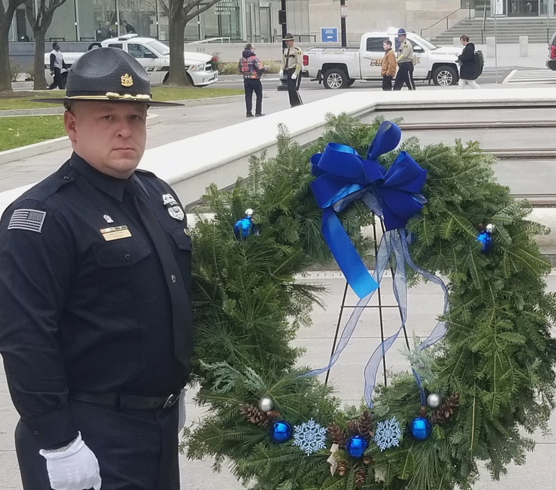 Hal Thayer, of Whitefield, stands with a wreath at the National Law Enforcement Officers Memorial in Washington, D.C. (Photo courtesy Hal Thayer)