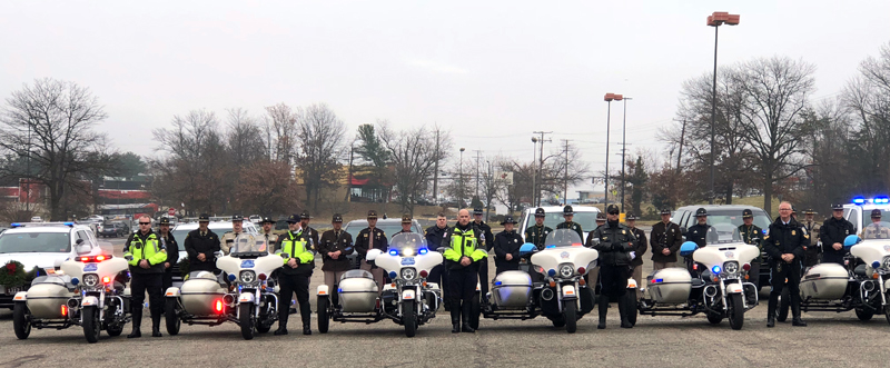 Representatives of multiple Maine sheriff's offices who volunteered with Wreaths Across America stand with police officers from Washington, D.C. (Photo courtesy Hal Thayer)