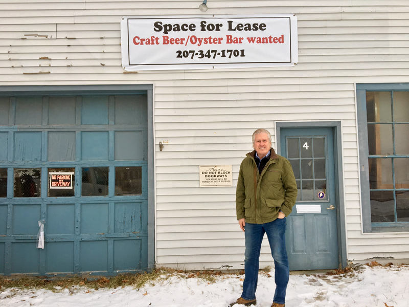 Craig Winslow stands in front of the Railroad Avenue side of his new building at 4 Railroad Ave. and 51 Water St. in downtown Wiscasset. (Suzi Thayer photo)