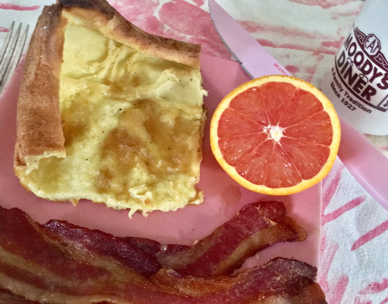 Swedish pancakes with butter (more butter) and maple syrup, served with bacon and an orange (to make it healthy). :-) (Suzi Thayer photo)