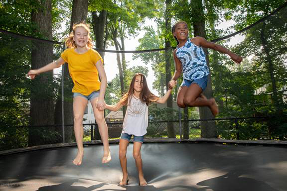 Treasure, from Brooklyn, N.Y., enjoys a beautiful day with her summer sisters, Caroline and Isabelle. (Photo courtesy Alex Steedman)