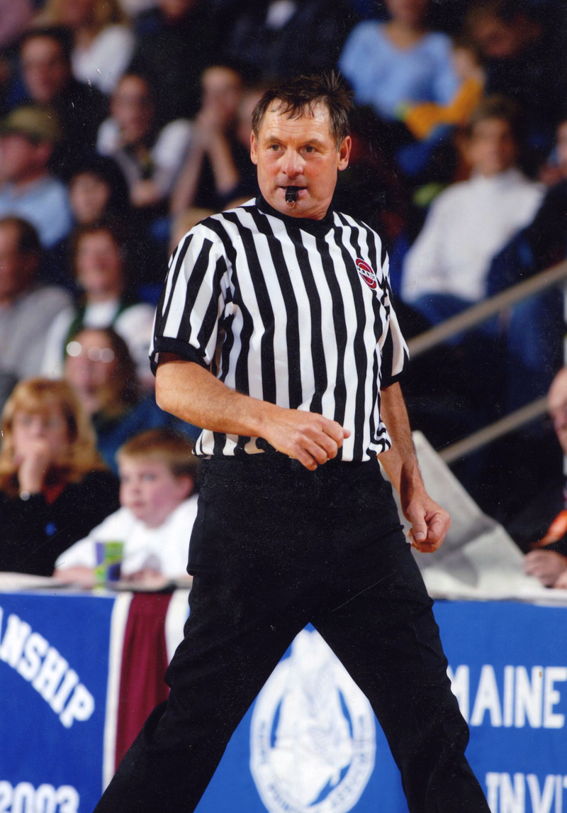 Walt Gorneau officiates a tournament game at the Augusta Civic Center in his younger years. (Photo courtesy Walt Gorneau)