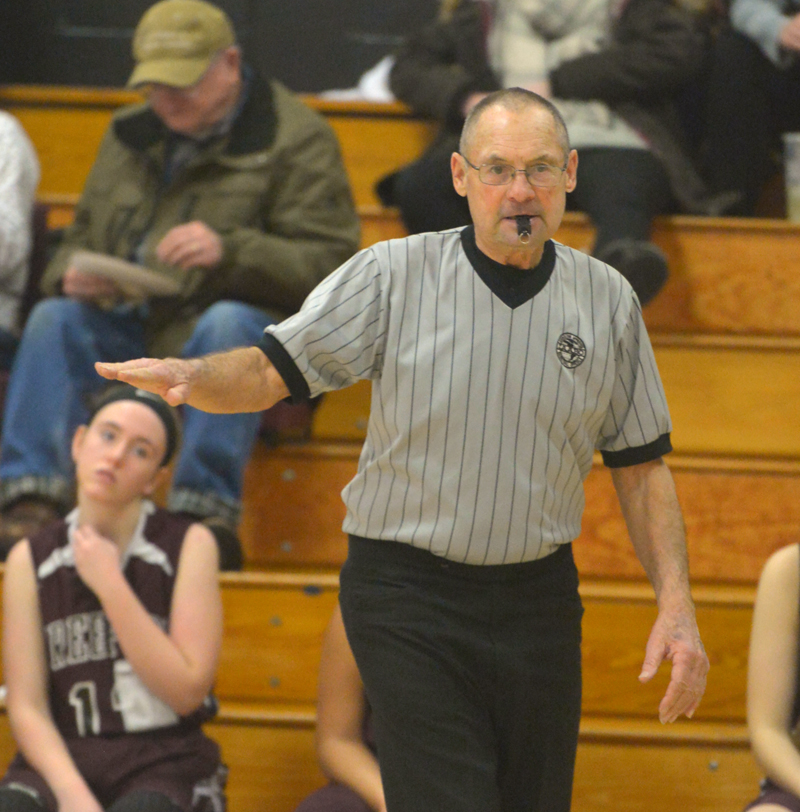 Walt Gorneau counts off the seconds to move the ball across half court during a recent basketball game at Lincoln Academy. (Paula Roberts photo)