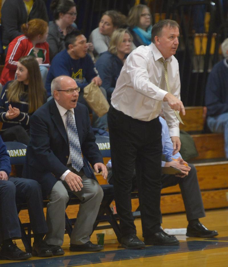 Volunteer assistant Jim Graffam and head Medomak Valley boys basketball coach Nick DePatsy react to a Panther play. (Paula Roberts photo)