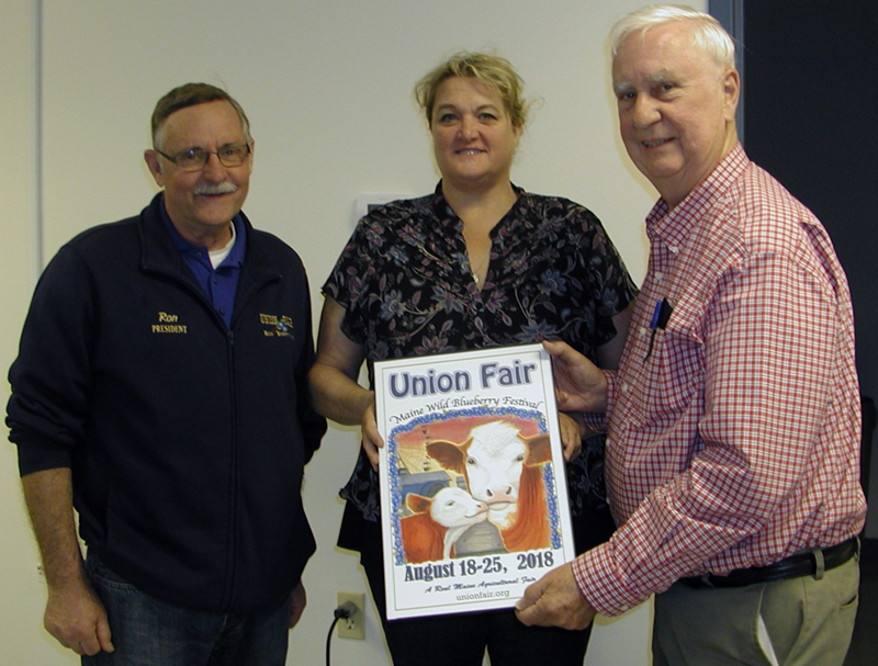From left: Union Fair/Maine Wild Blueberry Festival President Ron Hawes, 2018 Union Fair poster contest winner Gail Hawes, and poster contest chair George Gross display the 2018 Union Fair poster (Photo courtesy Union Fair)