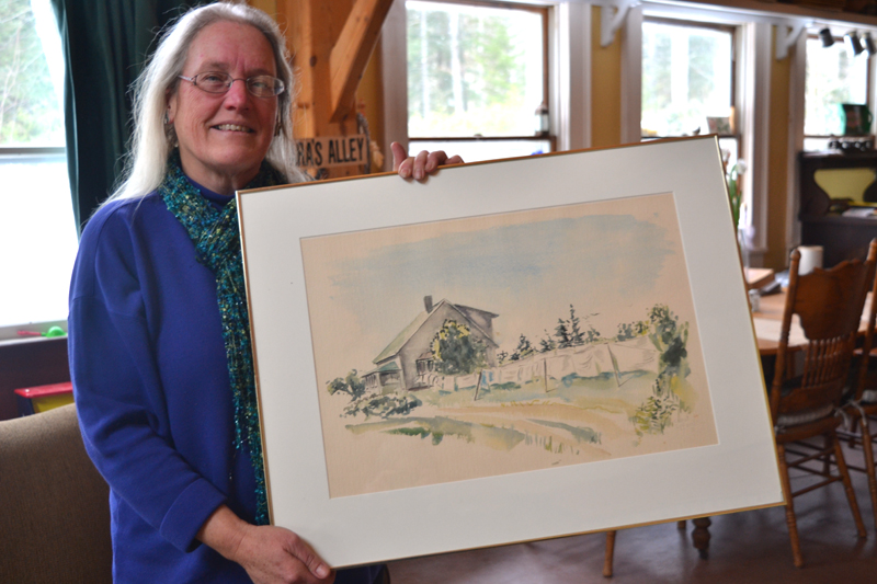 Julia Lane, daughter of the late Lincoln County sculptor Cabot Lyford, poses with one of her father's watercolor paintings at her Round Pond home Jan. 23. (Christine LaPado-Breglia photo)