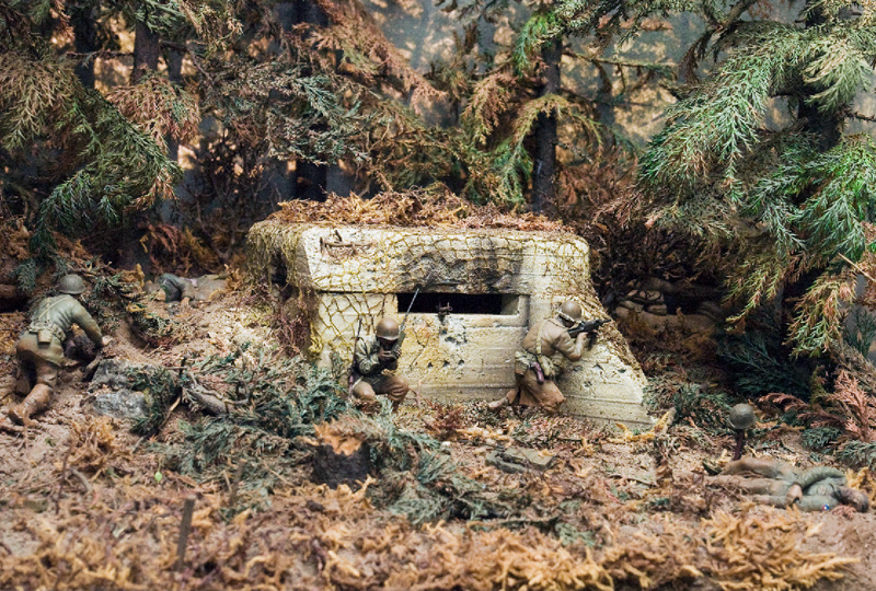 A diorama by Ed Strausberg depicts the U.S. Army in the Hurtgen Forest, Germany, 1944. The soldiers have just taken a German pillbox. (Jack Lane photo/courtesy Ed Strausberg)
