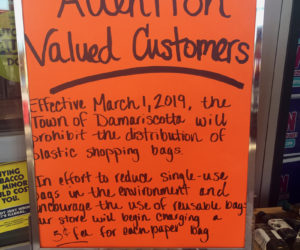 A sign at Hannaford Supermarket in Damariscotta informs customers that the town's ban on plastic bags will take effect Friday, March 1, and says the store will charge 5 cents per paper bag. (Jessica Picard photo)