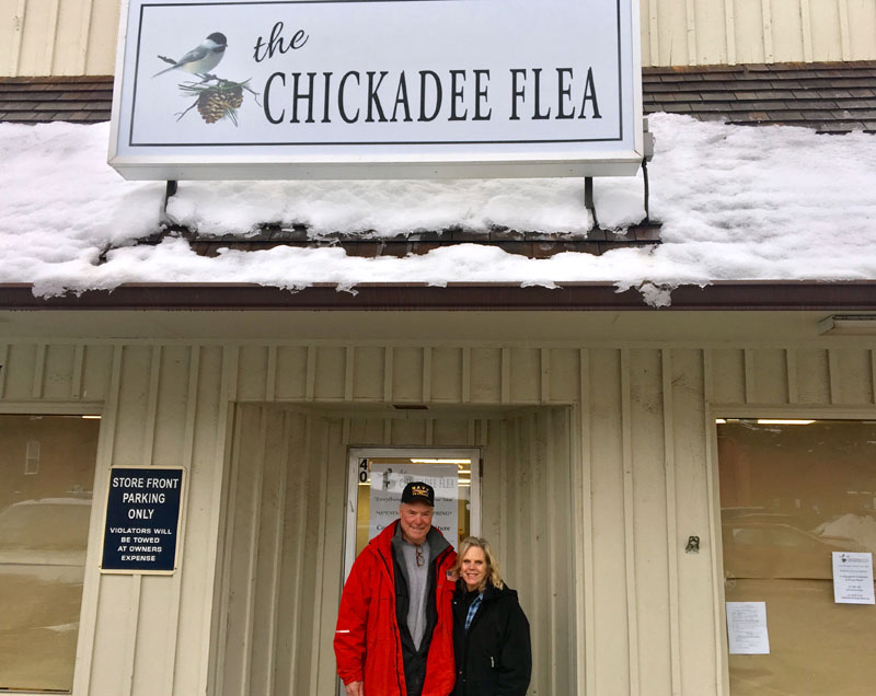 Paul and Trish L'Heureux stand in front of the door to their soon-to-open shop, The Chickadee Flea, at the Elm Street Plaza in downtown Damariscotta. The couple plans to open the shop in early spring. (Suzi Thayer photo)