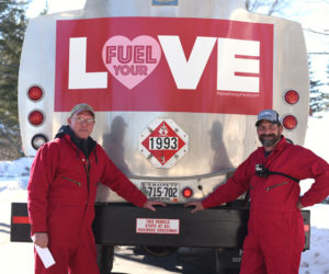 Ralph Eugley (left) and Nick Tilas, of Colby & Gale Inc., show off their decorated truck and special red uniforms for the Fuel Your Love event Thursday, Feb. 14. (Jessica Picard photo)